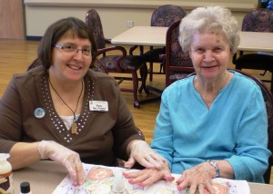 Pam Woolison, Activity Assistant, gives Pearl Kovacs a weekly manicure during an afternoon activity.